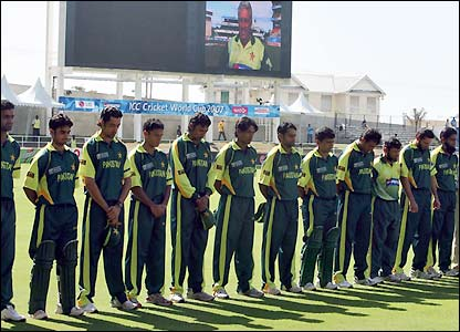 Pakistan's players remember their coach as his image appears on the big screen behind them