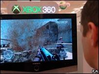 Man playing Xbox game