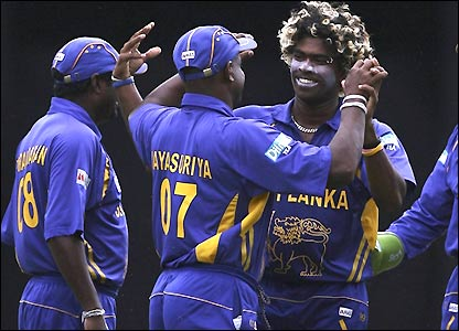 Lasith Malinga celebrates one of his wickets with team-mates