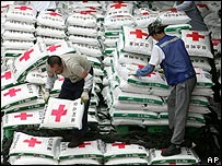 South Koreans prepare aid shipments for North Korea in July 2006