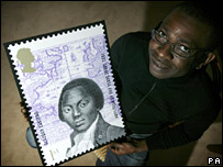 Youssou N'Dour with one of the stamps