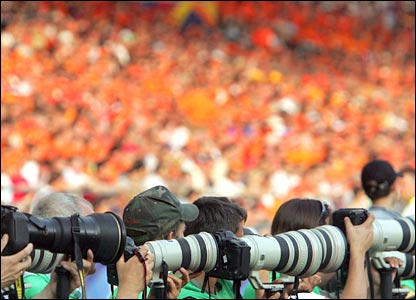 A picture of photographers during a football match involving Holland