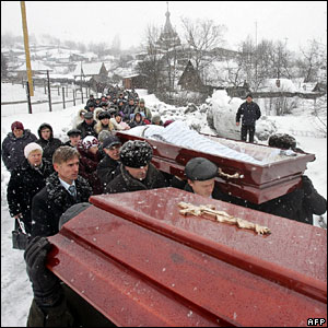 People carry the coffin of Ivan Artunyan, a miner killed at the Ulyanovskaya mine, during a funeral ceremony in Novokuznetsk, Siberia