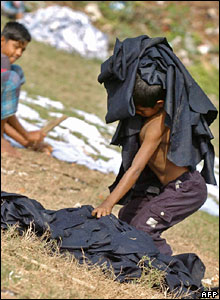 Rashid Ali loads pieces of manufactured animal skin onto his shoulders at Kamrangir chor on the outskirts of Dhaka, Bangladesh