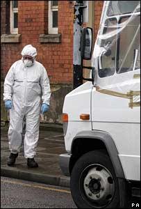 Forensic officer next to van