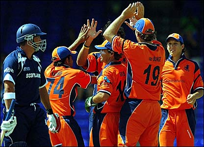 Scotland's Gavin Hamilton (left) trudges off while the Dutch players celebrate his dismissal