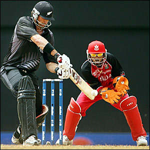 Stephen Fleming (left) hits a boundary