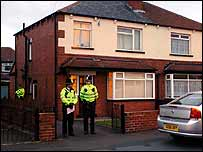 Police guard a house in Cardinal Road, Beeston