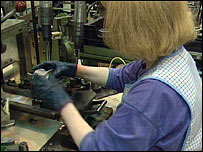 worker in UK manufacturing plant