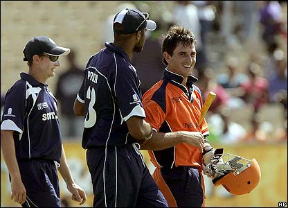 Ryan ten Doeschate is congratulated by Scotland's Navdeep Poonia