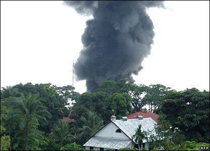 Smoke billowing from an oil refinery in Kinshasa