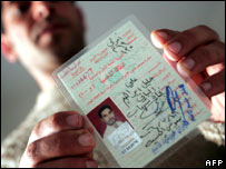 Iraqi refugee Ali al-Bayati ,26, shows his Iraqi ID