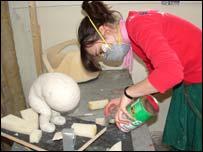 sculptor making plaster model