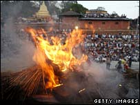 Mourners pay their respects during a mass cremation in Kathmandu