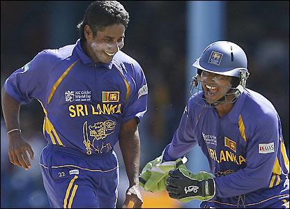 Kumar Sangakkara and Chaminda Vaas celebrate