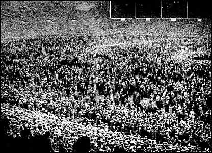 Crowds spill on to the pitch before the 1923 FA Cup final, the first match at the old Wembley Stadium
