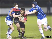 Garry Law and Scott Newlands tackle Edinburgh's John Senio