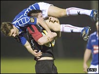 Chris Cusiter receives an unwelcome lift by Edinburgh's Ally Hogg