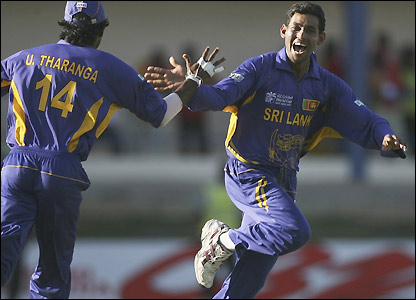 Tillakaratne Dilshan is congratulated by Upul Tharanga