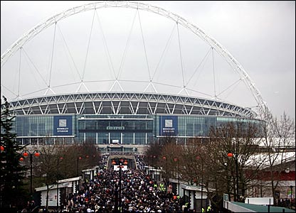 Fans walk up Wembley Way to the stadium