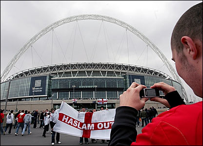 A supporter takes a picture of the new Wembley Stadium