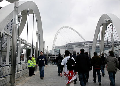Supporters walk across the White Horse footbridge