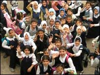 Iraq primary school children waving