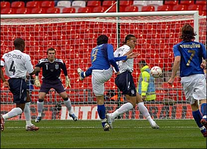 Giampaolo Pazzini scores Italy's opener via a slight deflection off Anton Ferdinand (second right)