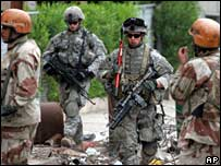 Iraqi and US troops conduct a sweep of the Karrada district of Baghdad