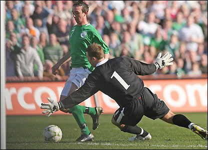 Stephen Ireland rounds Wales keeper Danny Coyne