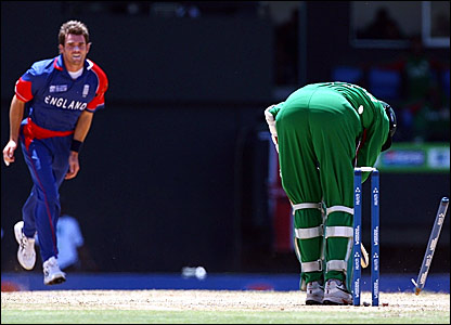England's James Anderson (left) bowls Ravi Shah