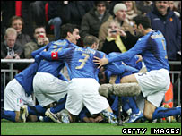 Italy players celebrate a goal after 29 seconds