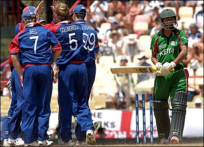 Tanmay Mishra (right) ambles off after being bowled by Paul Collingwood for 0