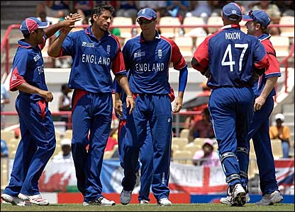 England players celebrate taking the wicket of Tony Suji