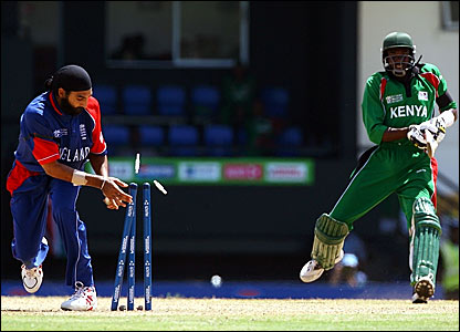 England's Monty Panesar (left) runs out Collins Obuya