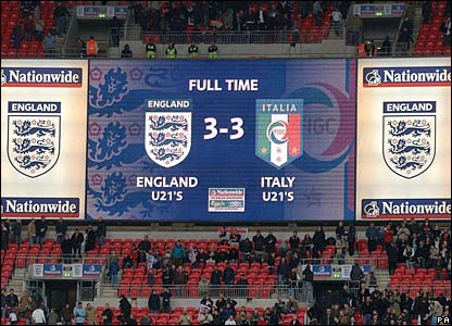 The Wembley scoreboard shows the final score at the end of the first match