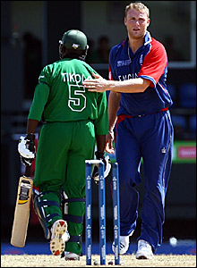 Kenya captain Steve Tikolo (left) is patted on the back by Andrew Flintoff after his dismissal