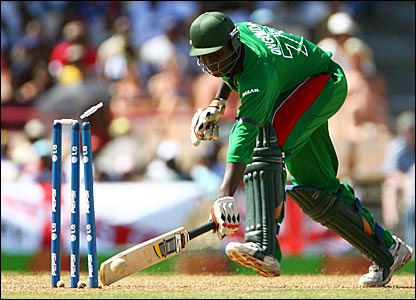Peter Ongondo is run out by Michael Vaughan's throw