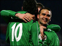 David Healy (right) celebrates his opening goal in Saturday's game