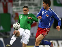 David Healy tries to hold off Michael Stocklasa
