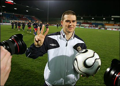 David Healy collects the match ball