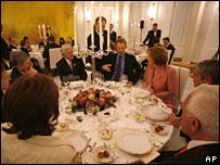 Tony Blair (centre) and Angela Merkel are among EU leaders attending a dinner