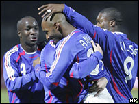 France celebrate Nicolas Anelka's (centre) goal