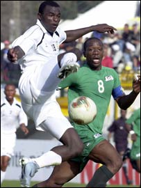 Kenya's Dennis Oliech (white shirt)
