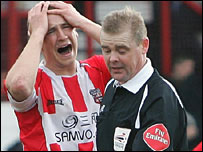 Andy Frampton of Brentford holds his head in his hands after the Bees concede a penalty