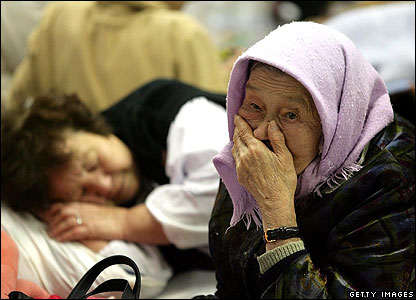 Old lady sitting in evacuation centre