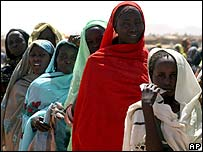 Women line up for a distribution of blankets in a refugee camp in northern Darfur