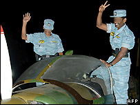Tamil Tiger rebels with one of their aircraft - undated file photo