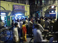 Residents of Calcutta watching World Cup match on television at a street corner