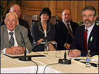 Ian Paisley and Gerry Adams sitting side-by-side